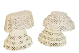 FOUR CREAMWARE PIERCED CURD MOULDS, 19TH CENTURY