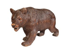 A 'BLACK FOREST' CARVED AND STAINED LINDEN WOOD MODEL OF A BEAR,
