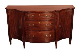 A GEORGE III MAHOGANY SERPENTINE FRONT COMMODE, IN THE MANNER OF GILLOWS,