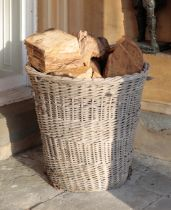A PAIR OF LARGE WICKER LOG BASKETS,