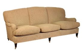 A HOWARD AND SONS THREE-SEATER SOFA