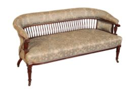 AN EDWARDIAN UPHOLSTERED LOW SETTEE