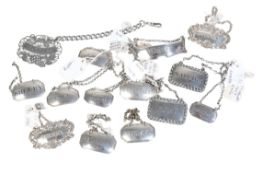 A GROUP OF SILVER WINE/DECANTER LABELS