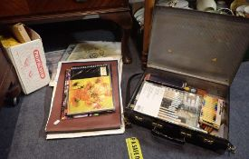 A QUANTITY OF ARTIST'S MATERIALS CONTAINED IN A JAPANNED CASE