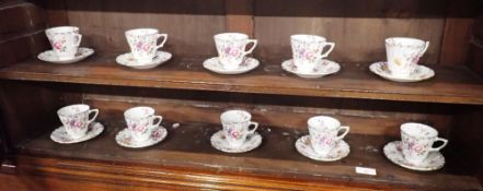 TEN ROYAL CROWN DERBY FLORAL AND GILT COFFEE CUPS AND SAUCERS