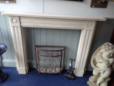 A RE-CONSTITUTED STONE FIREPLACE SURROUND