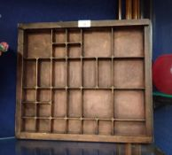 A VINTAGE WOODEN PRINTER'S TRAY