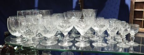 A COLLECTION OF FACETED DRINKING GLASSES