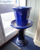 A BLUE GLAZED GARDEN BIRD BATH