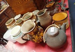 A COLLECTION OF STONEWARE STORAGE JARS