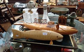 A CARVED WOOD ARTICULATED FISH