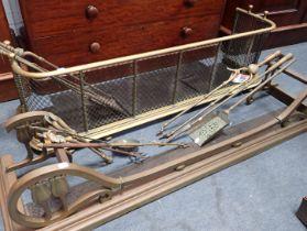 A 19TH CENTURY BRASS AND WIREWORK FENDER