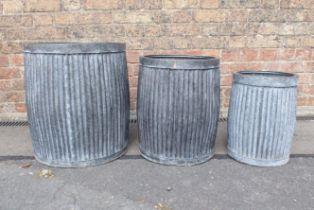 A GRADUATED SET OF THREE METAL PLANTERS