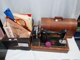 A VINTAGE SINGER SEWING MACHINE
