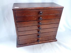 AN EARLY 20TH CENTURY STAINED PINE COLLECTOR'S CABINET