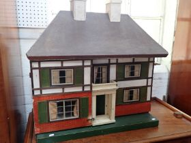 A LARGE 1930S DOLL'S HOUSE