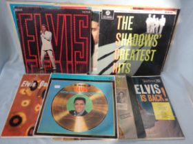 A COLLECTION OF ELVIS RECORDS
