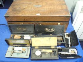 A WOODEN BOX CONTAINING CALIBRATING INSTRUMENTS