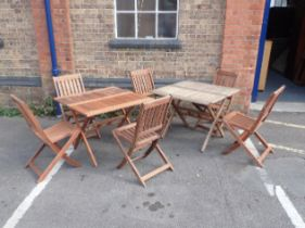TWO TEAK FOLDING GARDEN TABLES AND SIX CHAIRS
