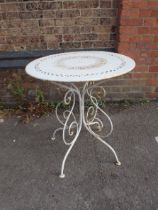 A WHITE PAINTED METAL GARDEN TABLE
