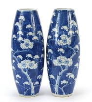 Pair of Chinese blue and white porcelain vases hand painted with prunus flowers, four figure