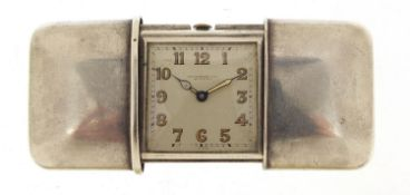 Movado, Art Deco silver self winding travel watch, retailed by Hausmann & Co, the case numbered