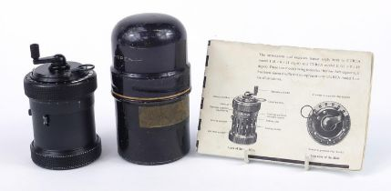 Vintage Curta calculator with instructions, serial number 510375