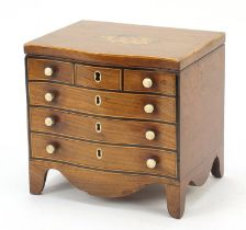 Victorian inlaid mahogany tea caddy in the form of a serpentine fronted six drawer chest, 17cm H x