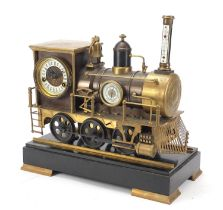 Large steam train design clock and barometer with thermometer having enamel dials, raised on a