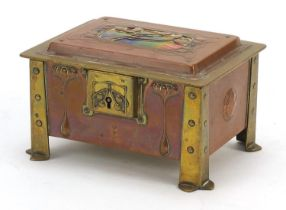 Arts & Crafts enamel, copper and brass casket with embossed floral motifs raised on four stylised