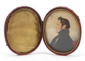 Georgian oval hand painted portrait miniature of a gentleman housed in a red leather case with