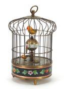 Brass clockwork automaton bird cage alarm clock with cloisonné band, 19.5cm high