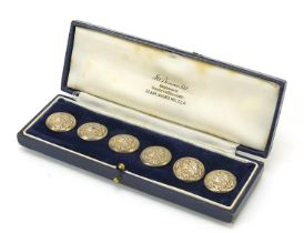 Abel & Charnell, set of six Art Nouveau silver buttons, embossed with a maiden's head, housed in a J
