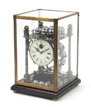 Champlevé enamel rolling ball clock with enamel dial having Roman numerals and glass display case,
