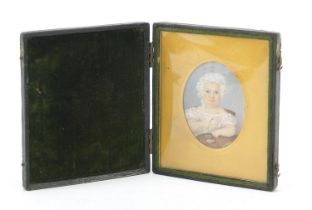 19th century oval hand painted portrait miniature of a young girl holding a rattle, housed in a