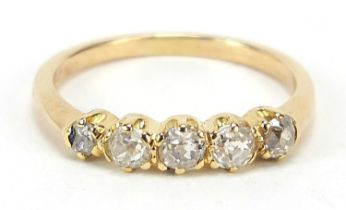 18ct gold graduated diamond five stone ring, housed in a velvet and silk lined leather box, size