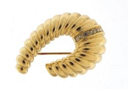 Christian Dior brooch set with clear stones, 4cm wide, 13.5g :