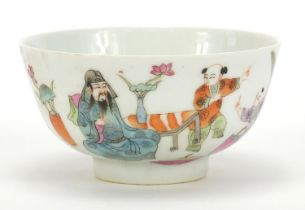 Chinese porcelain bowl hand painted in the famille rose palette with figures in a palace setting,