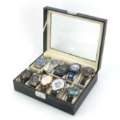 Ten gentlemen's wrist watches housed in a display case, including Megalith, Casio and Timex :For