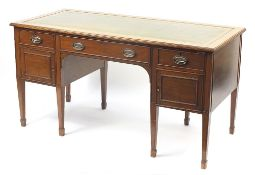 Edwardian mahogany pedestal writing desk with green tooled leather insert above three drawers and