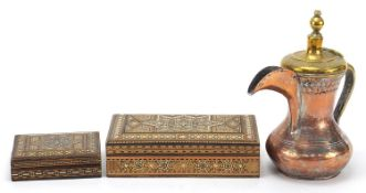Omani copper and brass coffee pot and two Syrian inlaid boxes, the largest 21cm wide :For Further