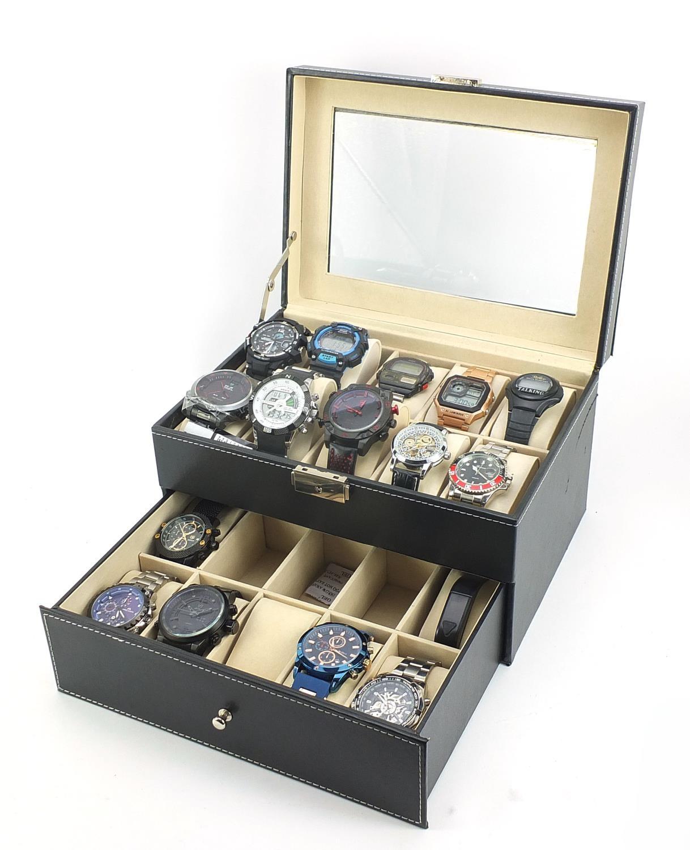 Fifteen gentlemen's wristwatches housed in a display case including Casio, Skmei, Weide and Biden :