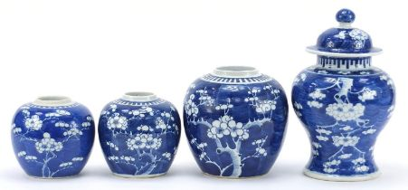 Chinese blue and white porcelain hand painted with prunus flowers, comprising a baluster vase with