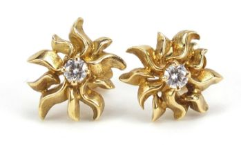 John Donald, pair of Modernist 18ct gold diamond solitaire stud earrings housed in a John Donald