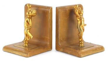 Pair of tooled leather and gilt metal Putti design bookends, each 17cm high :For Further Condition