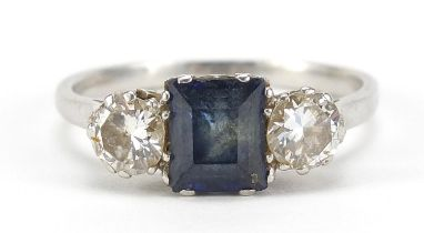 Unmarked platinum sapphire and diamond ring, the sapphire approximately 6.4mm x 5.0mm, the