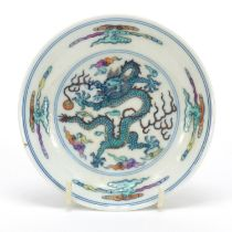 Chinese doucai porcelain dish hand painted with a dragon amongst clouds, six figure character