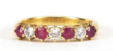 18ct gold diamond and ruby half eternity ring, the diamonds approximately 2.1mm in diameter, size N,