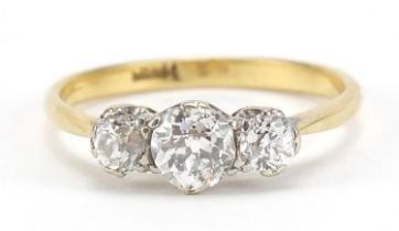 18ct gold diamond trilogy ring, the central diamond approximately 4.7mm in diameter, the smaller