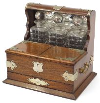 Victorian oak tantalus compendium with metal mounts and carrying handles fitted with three glass